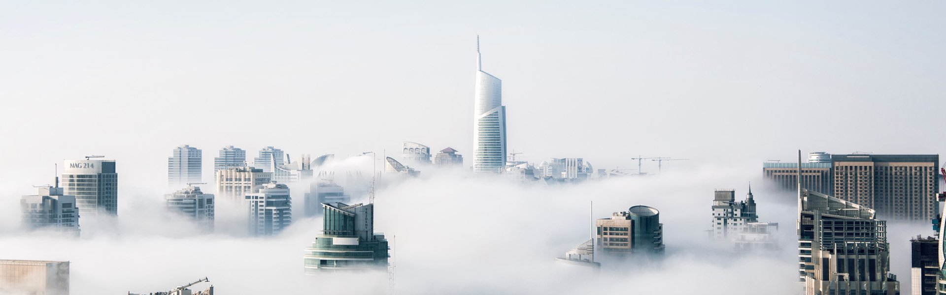 Buildings Rising Above The Clouds